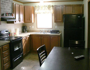 Kitchen in a unit at Amber Hills Lodging